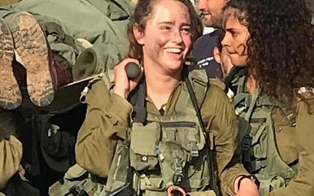 Exhausted and elated, Zoe Tal and her comrades finish infantry basic training with an all-night, stretcher march.