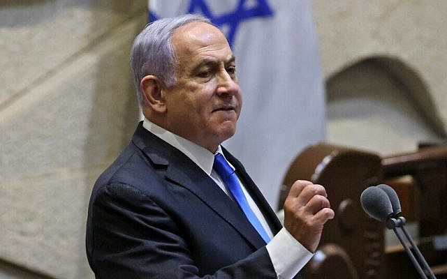 Israel's outgoing then-prime minister Benjamin Netanyahu addresses lawmakers during a special session to vote on a new government at the Knesset in Jerusalem, on June 13, 2021. (Emmanuel Dunand/AFP)