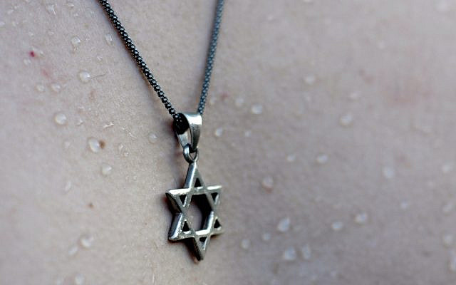A tourist wears a necklace with a Star of David.  November 30, 2012. Photo by Louis Fisher/Flash90.