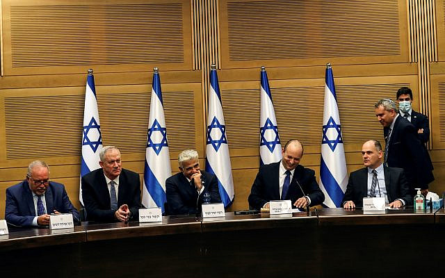 Israeli Prime Minister Naftali Bennett and some of his government attend its first cabinet meeting in the Knesset, Israel's parliament, in Jerusalem June 13, 2021. REUTERS/Ronen Zvulun