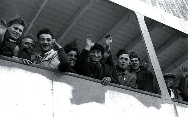 """FILE PHOTO 6APR48 - Newly arriving Jewish refugee from the Nazi Holocaust wave from the ship """"S.S. Awarea"""" as it pulls into Haifa port on April 6, 1948, five weeks before David Ben Gurion declared Israel a state on May 14, 1948. The ship brought in immigrants who had been stopped en route to Palestine after World War II and held in camps in Cyprus. Israel has absorbed well over two million Jews in its first 50 years, immigrants from Europe, the Middle East, North and South America and Africa drawn by the promise of shelter from adversity in the diaspora or a better Jewish way of life. They include 250,000 survivors of the Holocaust, Hitler's genocide of one third of the world's Jews. (Reuters)"""