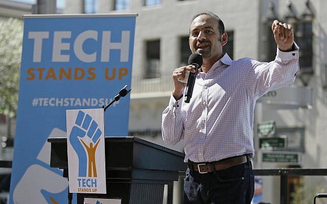 Dilawar Syed, in March 2017, at the time president of the software company Freshdesk, speaks during a Tech Stands Up rally outside City Hall in Palo Alto, Calif. (AP Photo/Eric Risberg)