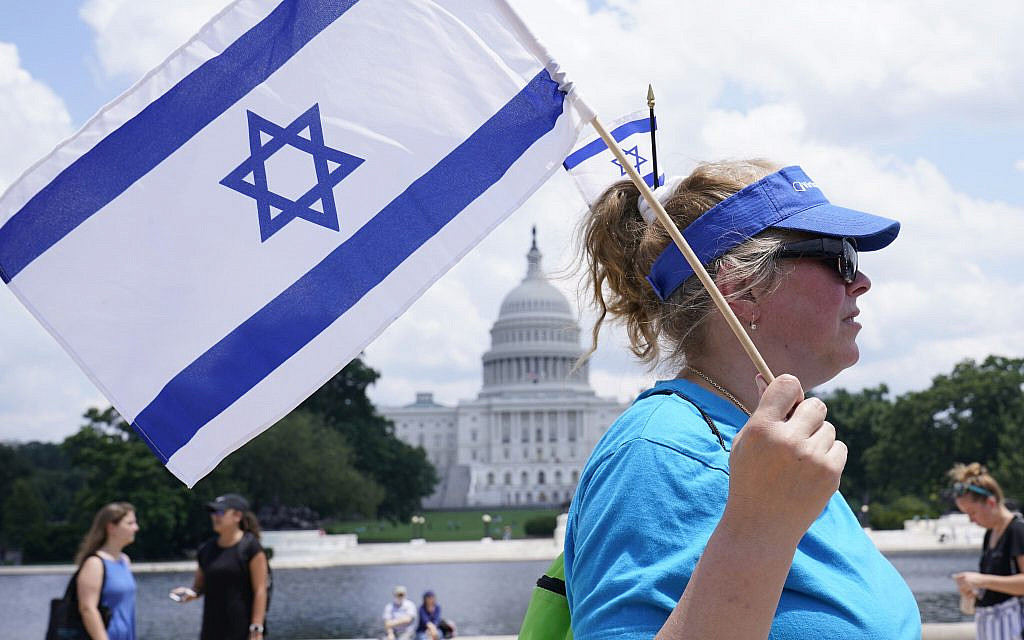 """Cara Altman of Livingston, N.J., attends the """"NO FEAR: Rally in Solidarity with the Jewish People"""" event in Washington, Sunday, July 11, 2021, co-sponsored by the Alliance for Israel, Anti-Defamation League, American Jewish Committee, B'nai B'rith International and other organizations. (AP Photo/Susan Walsh)"""