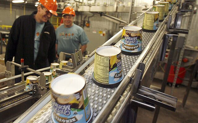 In this photo taken March 23, 2010, ice cream moves along the production line at Ben & Jerry's Homemade Ice Cream  in Waterbury, Vt. Ben & Jerry's is cutting about two dozen jobs at its Waterbury plant as part of a restructuring of its Vermont ice cream making operations.(AP Photo/Toby Talbot)
