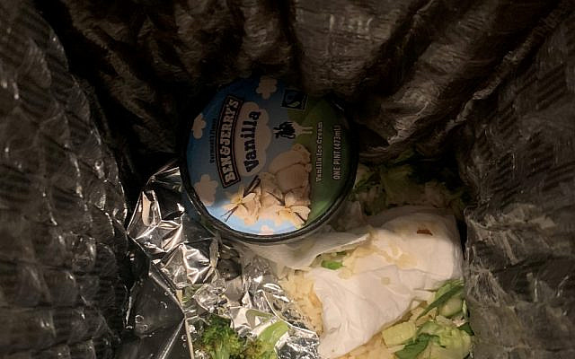 A pint of Ben & Jerry's ice cream in the garbage. (Twitter/@shea1012)
