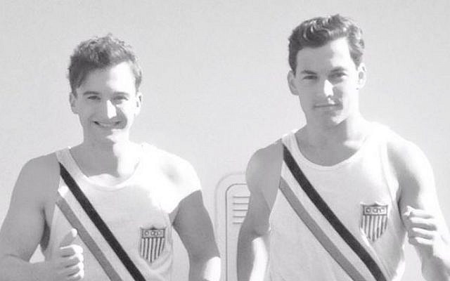 Marty Glickman and Sam Stoller, members of the United States track team, train on board the USS Manhattan, on their way to the 11th Summer Olympic Games in Berlin. —US Holocaust Memorial Museum, courtesy of Marty Glickman