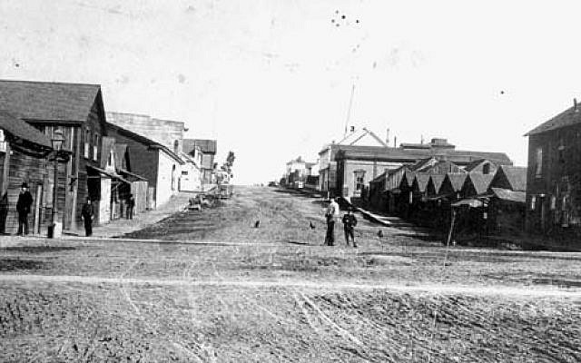This public-domain photo, published in The North Coast Journal and then uploaded to Wikipedia, shows Fourth and E streets in Eureka, Calif. Wikipedia notes that 'Chinatown is on the right and the first few buildings on the left.' It also noted that Eureka City Councilman David Kendall was shot and killed at this crossing.