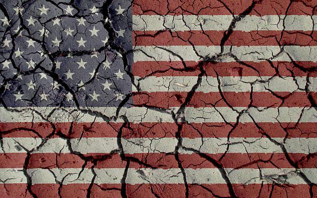 (US flag with mud cracks, iStock)