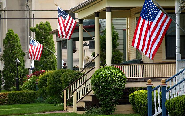 (American flags on porches image via iStock)