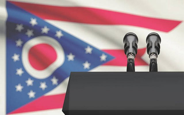 Pulpit and two microphones with US state flag on background - Ohio