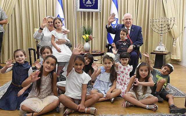 President of Israel Reuven Rivlin, and his wife host children who are entering first grade, towards the start of the school year, at the President's Residence, on August 31, 2017. (Mark Neyman / GPO)