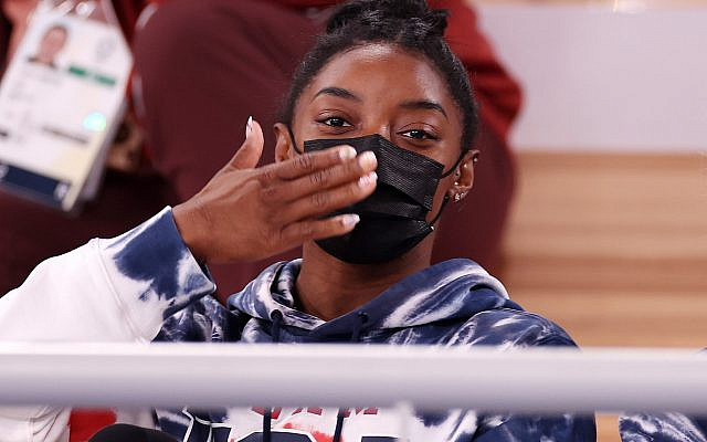 Simone Biles blows a kiss while watching the men's all-around gymnastic final at the Tokyo Olympic Games, July 28, 2021. (Jamie Squire/Getty Images via JTA)