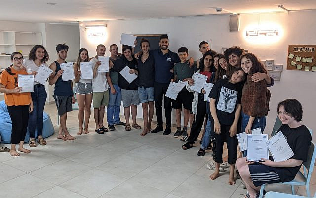 Chaim BePlus students completing financial course with Mentor Or Snir