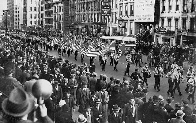 This photo shows a German-American Bund parade on East 86th St., in New York City, on Oct. 30, 1939. It was dedicated to installing a Nazi dictatorship in the United States, to join Nazi Germany. The photo is from Wikipedia and is in the public domain.