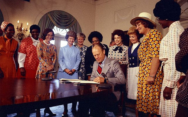 President Gerald R. Ford Signing the Proclamation on Women's Equality Day 1974 in the Cabinet Room. Bella Abzug (D-New York) stands second from right, beside Shirley Chisholm (D-New York) on right. (CC-PD via Wikipedia)