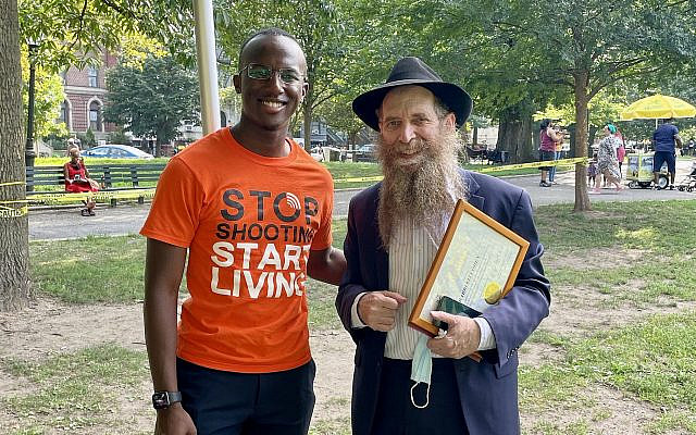 Brooklyn Borough Advocate Jibreel Jalloh, left, and Rabbi Eli Cohen of the Crown Heights Jewish Community Council attend the One Crown Heights festival, marking progress made on the 30th anniversary of the Crown Heights riots, August 2021. (Office of the Public Advocate Jumaane D. Williams)