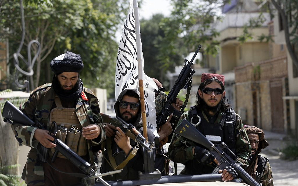 In this Aug. 19, 2021 photo, Taliban fighters display their flag on patrol in Kabul, Afghanistan.   (AP Photo/Rahmat Gul, File)