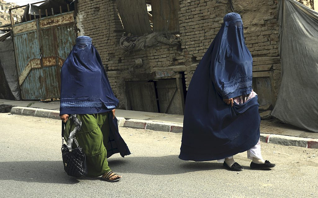 Afghan women in burqas walk on a street in Kabul, Afghanistan, Sunday, Aug. 22, 2021. (AP/Rahmat Gul)