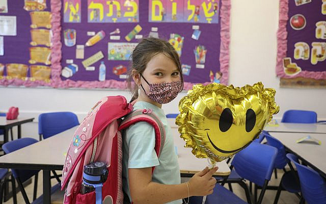 Students arrive to the classroom ahead of the opening of the school, at Orot Etzion School, in Efrat in the West Bank on August 30, 2021. (Gershon Elinson/Flash90)