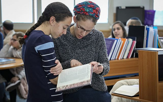 Illustrative: Young Jewish women study Talmud at the women's beit midrash (study hall) in Migdal Oz, Gush Etzion, on January 2, 2019. (Gershon Elinson/Flash90)