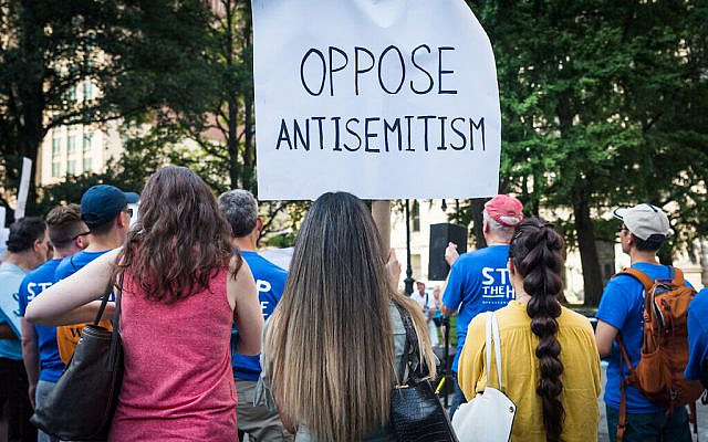 Protesters with a sign opposing antisemitism (Photo by Gabriele Holtermann-Gorden/Sipa via antisemitism)