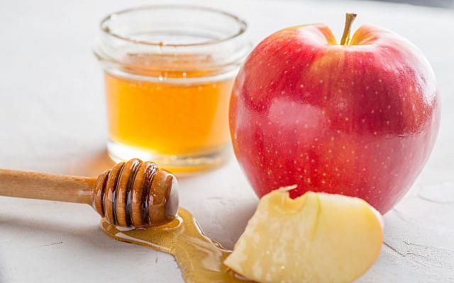 (apple and honey image via iStock)