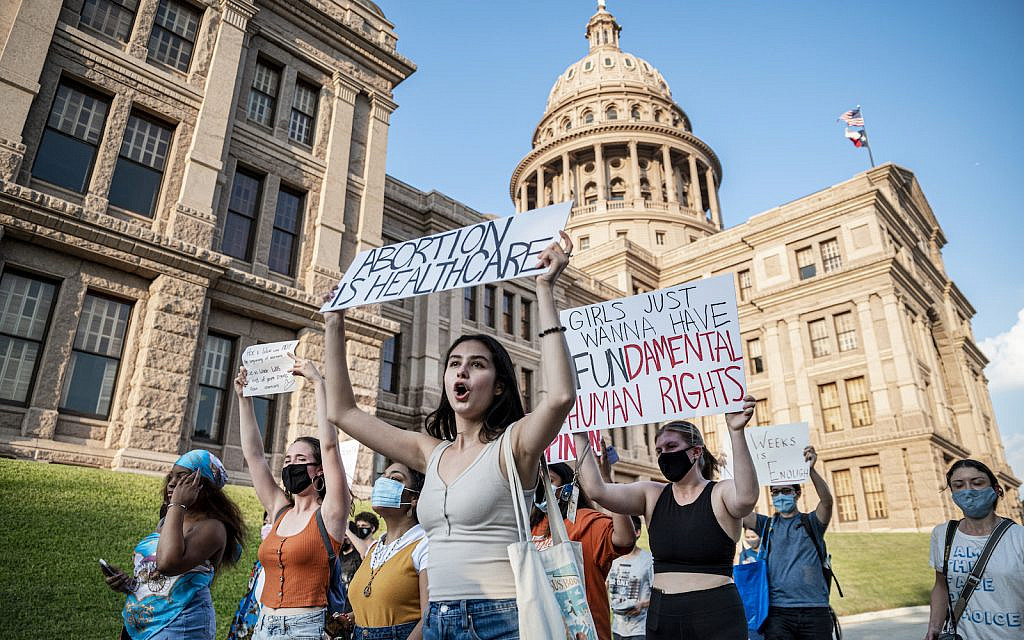 Pro-choice protesters march outside the Texas State Capitol in Austin on Wednesday, Sept. 1, 2021 as Texas passed a law which effectively bans nearly all abortions. (Sergio Flores For The Washington Post via Getty Images)