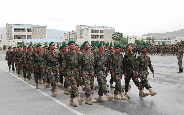 KABUL, Afghanistan -- Afghan National Army soldiers take part in a combined gradution ceremony at the Kabul Military Training Center July 29, 2010. The ceremony was held for 2,698 soldiers graduating from Kandak 135 basic warrior training, officer candidate school, up-armored humvee training, and cooking school. Graduations such as these contribute to the ANA goal of 134,000 trained soldiers -- a goal that will be met two months early. (Photo by U.S. Army 1st Lt. Joel Newburn)