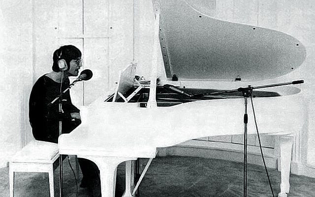 John Lennon, as pictured in an advertisement for Imagine from Billboard, September 18, 1971. (Public Domain, via Wikipedia)