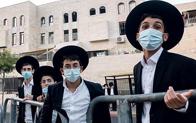 Ultra Orthodox young Jewish men with masks on in Jerusalem. (Credit Image: © Nir Alon/ZUMA Wire)