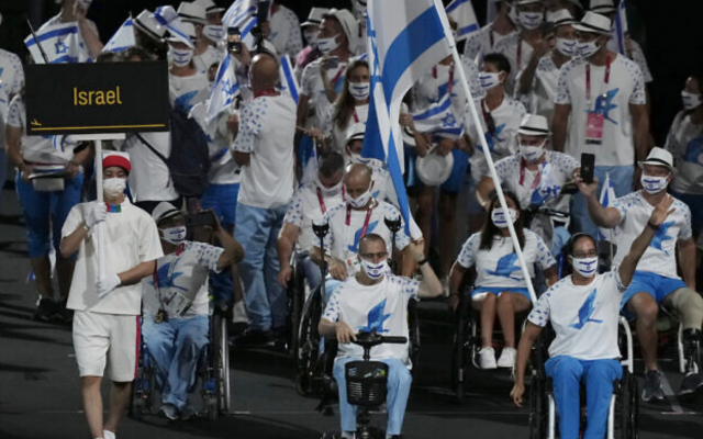 Athletes from Israel enter the stadium during the opening ceremony for the 2020 Paralympics at the National Stadium in Tokyo, Tuesday, Aug. 24, 2021. (AP Photo/Emilio Morenatti)