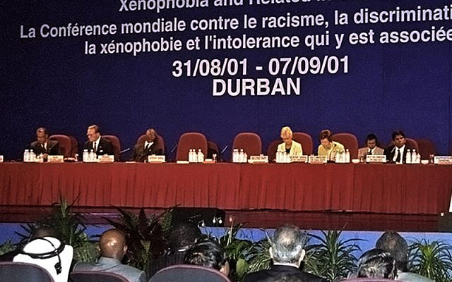 Secretary-General Kofi Annan (right at podium) speaking at the opening of the World Conference Against Racism, Racial Discrimination, Xenophobia and Related Intolerance in Durban.