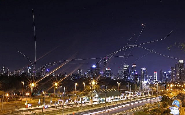 TOPSHOT - Israel's Iron Dome air defence system intercepts rockets above the coastal city of Tel Aviv on May 15, 2021, following their launching from the Gaza Strip controlled by the Palestinian Hamas movement. (Photo by ahmad gharabli / AFP) (Photo by AHMAD GHARABLI/AFP via Getty Images)