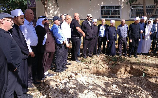 Planting a tree in Rahat with Jewish, Muslim, Christian and Druze friends. (courtesy)