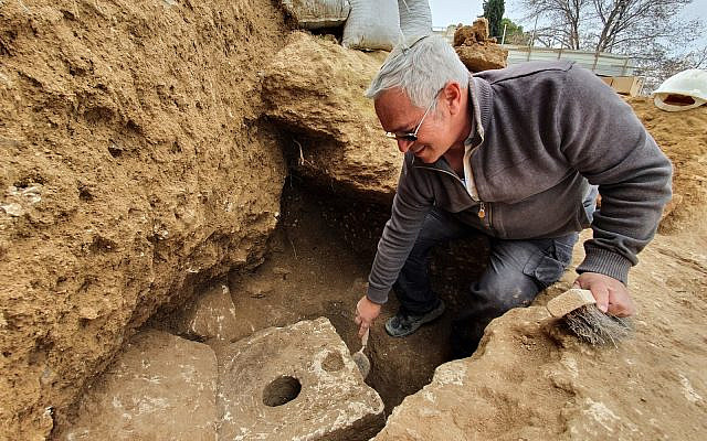 An Israel Antiquities Authority archeologist at the site of the recently unearthed toilet from the First Temple-period in Jerusalem (Yoli Schwartz / Israel Antiquities Authority)
