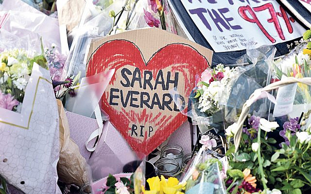 People paying their respects and laying floral tributes for Sarah Everard at the bandstand in Clapham Common, the day after the cancelled vigil. Credit: Matthew Chattle/Alamy Live News (Jewish News)