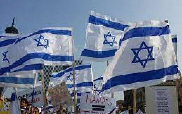 Israeli flags at a pro-Israel march, via Creative Commons