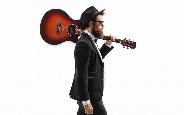 bigstock-Musician-walking-with-an-acous-403491101.jpg