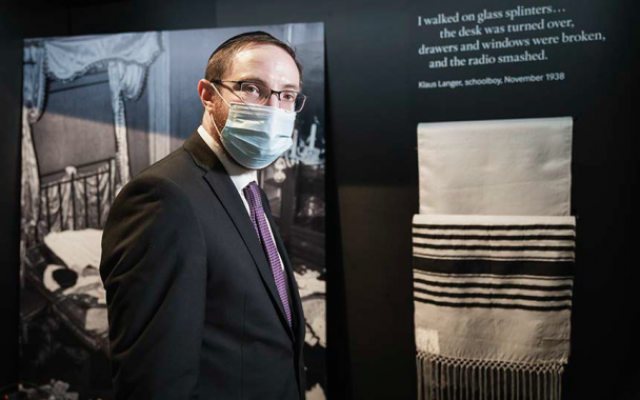 Rabbi Nicky Liss with the prayer shawl which Imperial War Museum officials asked him to help install
