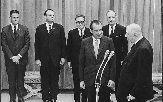 Background: H.R. Haldeman, John D. Ehrlichman, Henry A. Kissinger, William P. Rogers; Foreground: Richard M. Nixon, Charles DeGaulle. @U.S. National Archives and Records Administration