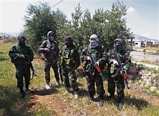 Lebanese pro-Syrian Popular Committees fighters near the northeastern Lebanese town of al-Qasr, Lebanon.(photo credit: AP Photo/Bilal Hussein)