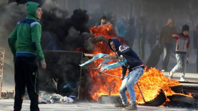 000_یک جوان فلسطینی در زدوخورد با نیروهای امنیتی اسرائیل در شهر قباطیه، در نزدیکی جنین، شمال کرانه باختری - جعفر آشتیه . خبرگزاری فرانسه