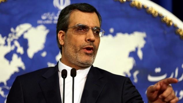 سخنگوی جدید وزارت خارجه ایران، حسین جابری انصاری در کنفرانس مطبوعاتی هفتگی - عطا کناره - خبرگزاری فرانسه