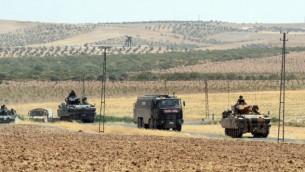 عکسی از نیروهای ترکیه ۲۷ آگوست ۲۰۱۶ در حال بازگشت از مرز سوریه، در کارکامیش ترکیه