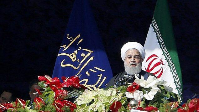 حسن روحانی در سخنرانی مراسم سالگرد پیروزی انقلاب اسلامی (11 فوریه 2018)  (AFP PHOTO / ATTA KENARE)