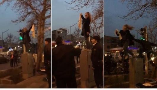 صحنه ای از بازداشت یکی از زنان معترض به حجاب اجباری در ایران