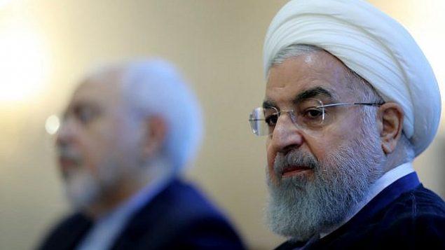 توضیح تصویر: در این عکس که در وبسایت رسمی ریاست جمهوری ایران منتشر شده، حسن روحانی رئیس جمهور حین حضور در ملاقاتی با گروهی از مقامات وزارت خارجه در تهران، دیده می شود. ایران، 22 ژوئیه 2018.