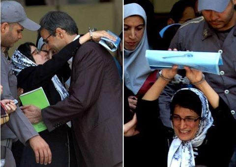 نسرین ستوده در حالیکه دستبند به دست دارد، در مقابل دادگاه همسرش رضا خندان را در آغوش می گیرد