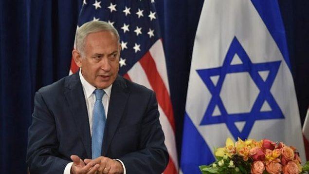 تصویر: بنیامین نتانیاهو نخست وزیر حین گفتگو در ملاقاتی با دونالد ترامپ رئیس جمهور ایالات متحده (که در عکس دیده نمی شود)، ۲۶ سپتامبر ۲۰۱۸، نیویورک، در دیدارهای حاشیه مجمع عمومی سازمان ملل.  (AFP PHOTO / Nicholas Kamm)