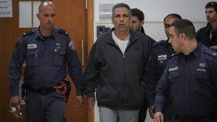 تصویر: گونن سیگیف وزیر پیشین انرژی در دادگاه ناحیه اورشلیم که برای استماع حکم محکومیت در یک پرونده جاسوسی ایران حضور یافته بود، ۲۶ فوریه ۲۰۱۹. (Yonatan Sindel/Flash90)
